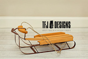 http://images.cdn.bigcartel.com/bigcartel/product_images/81191421/max_h-1000+max_w-1000/Wooden_Sled_LOGO.jpg